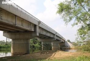 QUẾ SƠN- Lạ lùng cầu gần 40 tỷ đồng xây xong không có đường dẫn